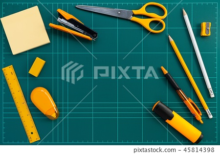 orange stationery office supplies on cutting mat 45814398