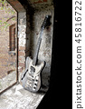 burned guitar in an abandoned factory 45816722