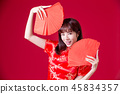 Chinese woman show red envelope 45834357