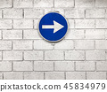 white arrow on blue road sign hanging on wall 45834979