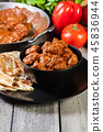 Chicken tikka masala served with bread naan 45836944
