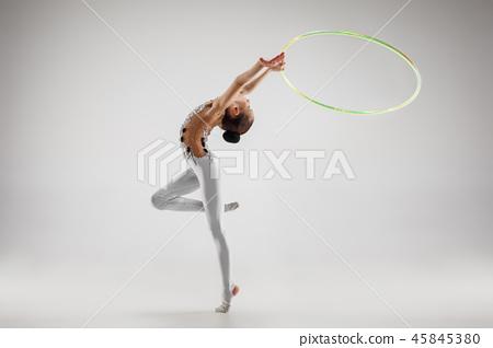 The teenager girl doing gymnastics exercises isolated on white background 45845380