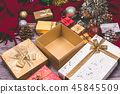 gift box and Christmas decorations on wooden table 45845509