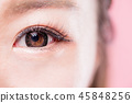 woman with circle contact lenses 45848256
