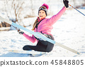 Woman falling while doing cross country skiing 45848805