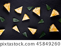 Fresh pineapple on black wood, black background. 45849260
