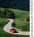 Car roadtrip on mountain road, Dolomites, Italy 45849587
