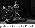 Pretty Latin young women working out in an elliptical trainer in 45850502