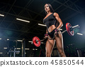 Portrait Of A Young Physically Fit Woman Showing Her Well Traine 45850544