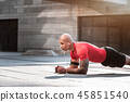 Serious handsome sportsman developing his muscle strength 45851540