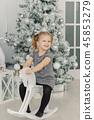 beautiful little girl in a white dress like a 45853279