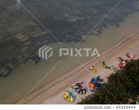 Aerial views, top view of kitesurfing on the waves 45858449