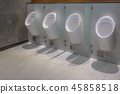 White urinals with white in the men toile 45858518