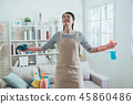 carefree housewife opening arms smiling 45860486
