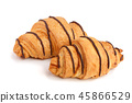 croissant decorated with chocolate sauce isolated on white background, top view 45866529
