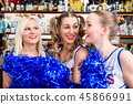 Group of cheerleader girls watching a game of their favorite team 45866991