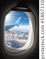 Commercial Airplanes Flying above the Clouds 45867330