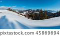Winter mountain rural snow covered hill slope 45869694