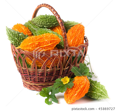 bitter melon or momordica in a wicker basket isolated on white background 45869727