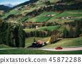 Roadtrip by car on mountain road in Dolomites 45872288