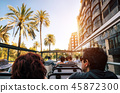 Tourists on open top sightseeing bus in city 45872300