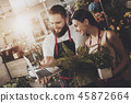 Portrait of smiling florists man and woman 45872664