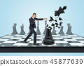 A small businessman stands on a chess board and hits a large black king and destroys it into small 45877639