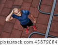 Young african man at the open air gym is resting after doing exercises. Top view 45879084