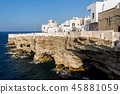 houses on dramatic cliffs caves, Polignano a Mare 45881059