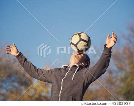 Soccer Player Balancing Football 45882957