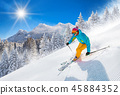 Skier skiing downhill in high mountains 45884352