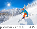 Skier skiing downhill in high mountains 45884353