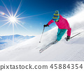Skier skiing downhill in high mountains 45884354