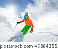 Skier skiing downhill in high mountains 45884355