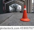 parking cone white and orange near building 45900767
