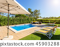 Sun bath with sun loungers and parasol. In Portugal. 45903288