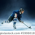 Little boy playing ice hockey 45906018