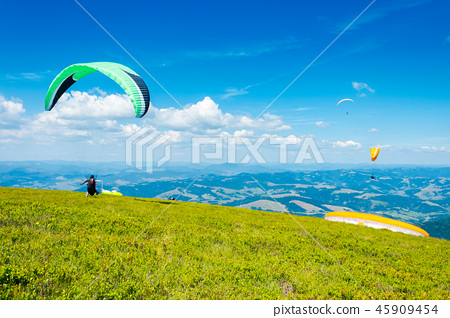 Skydiving extreme training in mountains 45909454