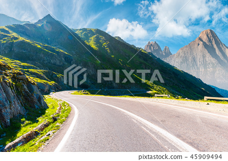 road in mountains with rocky ridge in the distance 45909494