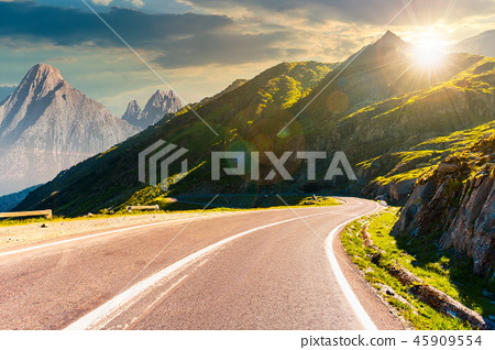 road in mountains with rocky ridge at sunset 45909554