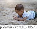 Asian toddler baby thai girl playing with sand 45910573