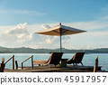 lounge chairs and umbrellas in Phuket ,Thailand. 45917957