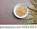 Organic Paddy Seeds, Rice on wood background. 45923653