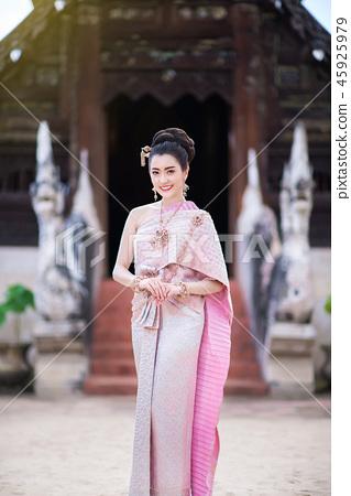Beautiful Thai girl in Thai traditional costume. 45925979