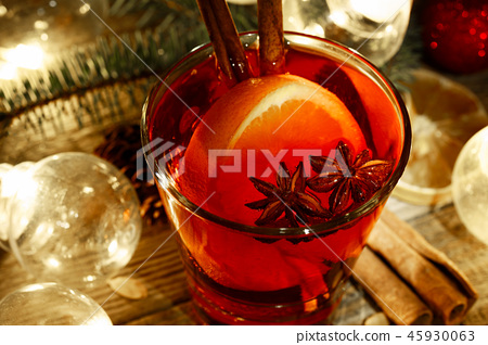 Mulled wine in a glass on a wooden background 45930063