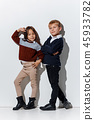 The portrait of cute little boy and girl in stylish jeans clothes looking at camera at studio 45933782