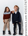 The portrait of cute little boy and girl in stylish jeans clothes looking at camera at studio 45933797