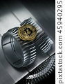 Golden bitcoin crypto currency on gearwheel 45940295
