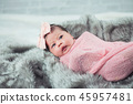 Portrait of cute baby on the bed 45957481