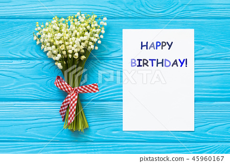 Happy Birthday greeting card and flowers on wooden background 45960167